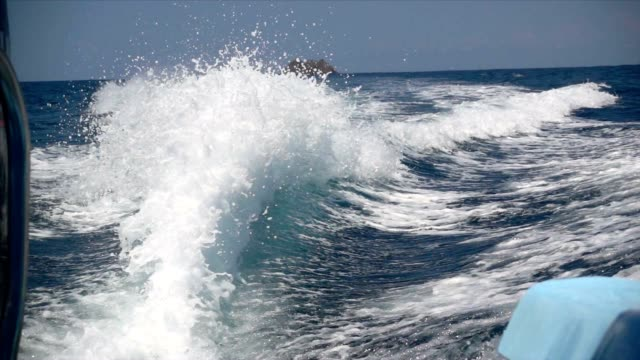 slo mo wake of a motorboat - boat point of view stock videos and b-roll footage