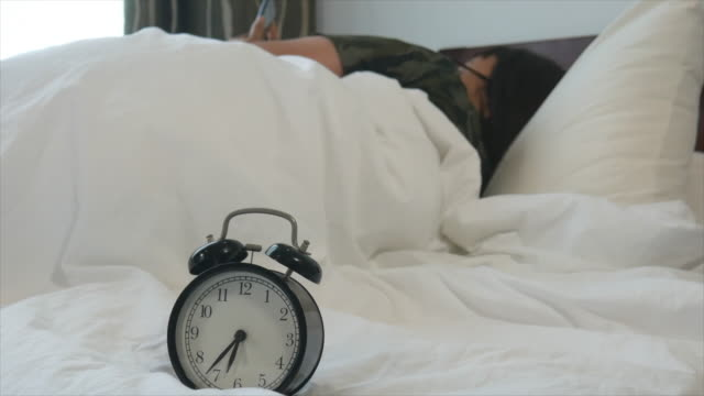 wake up. woman and alarm clock. - sequential series stock videos & royalty-free footage