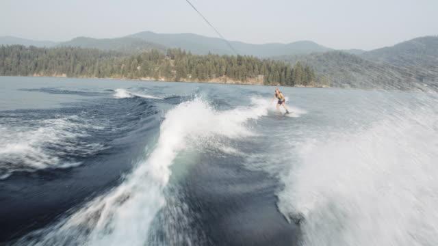4k uhd: wakeboarder getting huge air - waterskiing stock videos & royalty-free footage
