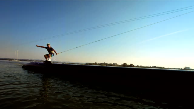 hd slow motion: wakeboarder grinding on the pipe - wakeboarding stock videos and b-roll footage