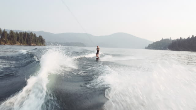 4k uhd: wakeboarder nearly landing a backflip - wakeboarding stock videos and b-roll footage