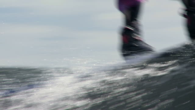 wakeboarder on lake in slow motion - menschliches bein stock videos and b-roll footage