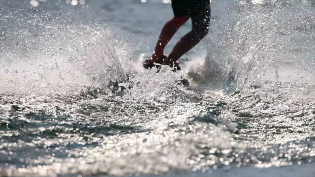 hd wakeboarder on lake in the backlight sm - waterskiing stock videos & royalty-free footage