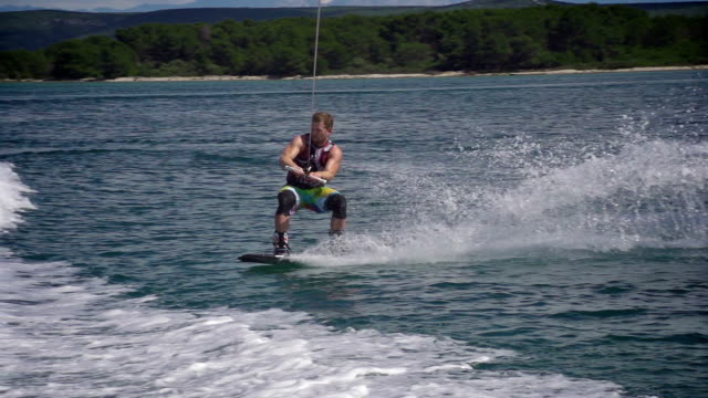 wakeboarder performing a trick - wakeboarding stock videos and b-roll footage