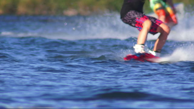 wakeboarders on lake - wakeboarding stock videos and b-roll footage