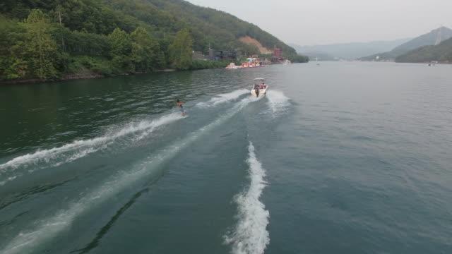 wakeboarding on cheongpyeongho lake / gapyeong-gun, gyeonggi-do, south korea - acquascooter video stock e b–roll