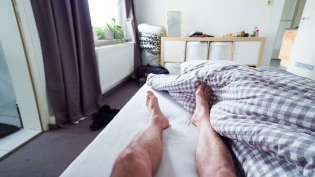 pov: waking up in the morning - duvet stock videos & royalty-free footage