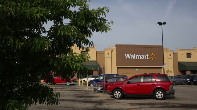 a wal mart stores inc retail location stands in louisville kentucky us on friday may 15 2015 shots wide shot of full walmart parking lot wide shot of... - help wanted sign stock videos and b-roll footage
