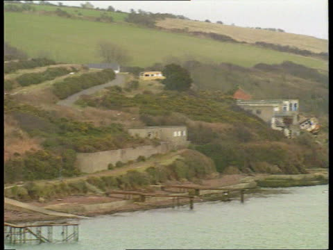 adele james murder man held wales dyfed pembroke dock gv headland across bay where body of adele james found pan rl - pembroke stock videos & royalty-free footage