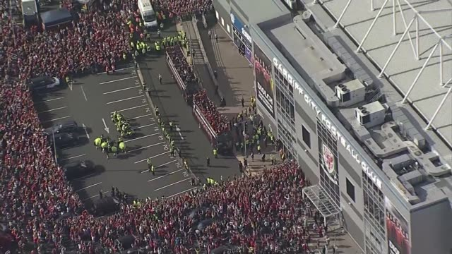 wales beat moldova in world cup qualifier; lib / tx cardiff: wales players leading the crowd in the iceland clap air view / aerial crowds and buses... - cardiff wales stock videos & royalty-free footage