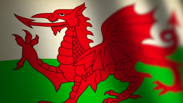 vídeos y material grabado en eventos de stock de bandera de país de gales - lazo. 4k. - gales