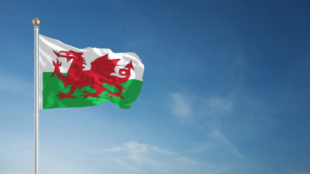 4k wales flag - loopable - wales stock videos & royalty-free footage