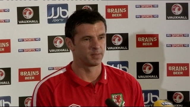 Wales football manager Gary Speed found dead at his home in Chester LIB / 2532011 Cardiff INT Wide shot of Speed at press conference Gary Speed press...
