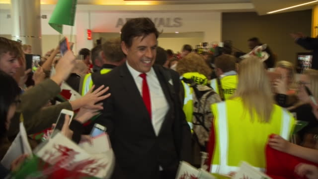 Wales manager Chris Coleman signing autographs for fans at Cardiff Airport after his team arrives back from reaching the semifinals of Euro 2016