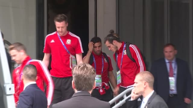 wales players return to training camp following quarter final win france lille ext wales players along from hotel including gareth bale crowds behind... - quarterfinal round stock videos & royalty-free footage