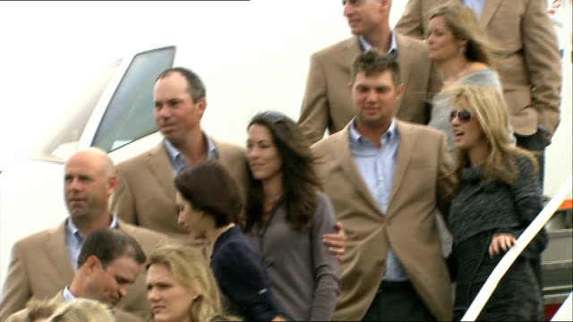 wales stages ryder cup for first time wales cardiff ext members of us ryder cup gold team stand on steps of aircraft with wives and girlfriends team... - pga event stock videos and b-roll footage