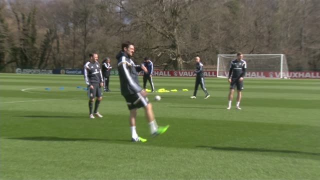 wales training ahead of crucial group b euro qualifier in haifa wales ext welsh national team players training gvs / gareth bale lines up ready for... - haifa stock videos and b-roll footage