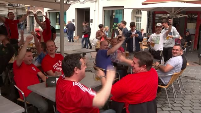 Wales v Belgium FRANCE Lille EXT Various shots Wales fans drinking Vox pop