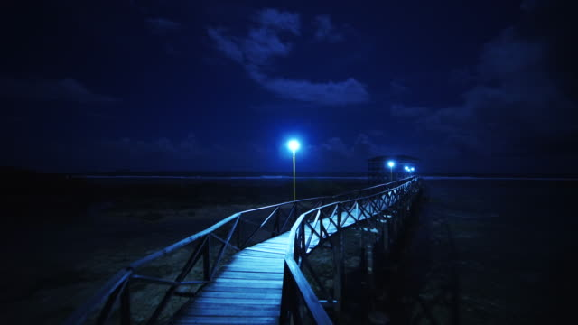 pov walk at night on narrow bridge in philippines - abwesenheit stock-videos und b-roll-filmmaterial