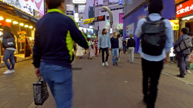 pov walk in the streets of shibuya in tokyo, japan - walking point of view stock videos and b-roll footage