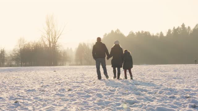 Walk on a snowy field