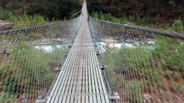 pov walk on a suspension bridge in nepal - narrow stock videos and b-roll footage