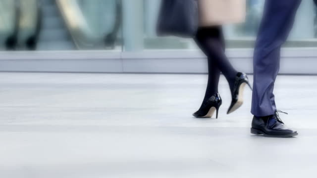 walk on by. city man and woman.. - sidewalk stock videos & royalty-free footage