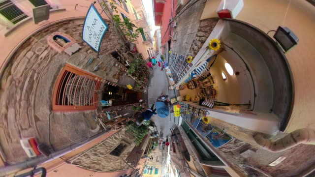 zo / pov / a walk through an alley in italian village with little planet effect - 360 video stock videos & royalty-free footage