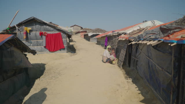 Walk through Kutupalong refugee camp in Bangladesh through homes along a high ridge Fleeing persecution by the Myanmar government and Rakhine...