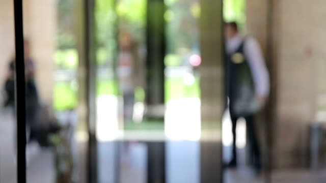 walk through revolving door - greeting stock videos & royalty-free footage