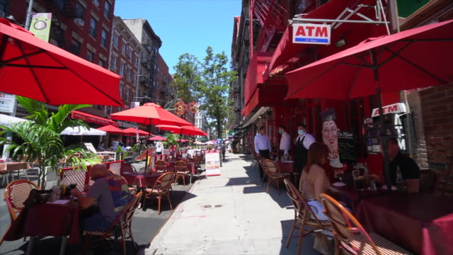 walk through shot restaurants and bars set tables and chairs on the street and keep social distancing each other and prepare to phase three opening - italian culture stock videos & royalty-free footage