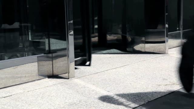 walk - revolving door stock videos & royalty-free footage