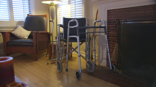walker and wheelchair in living room - mobility walker stock videos and b-roll footage