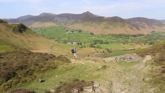 walker checking a gps unit, newlands valley, lake district national park, cumbria, england. - only mature men stock videos & royalty-free footage