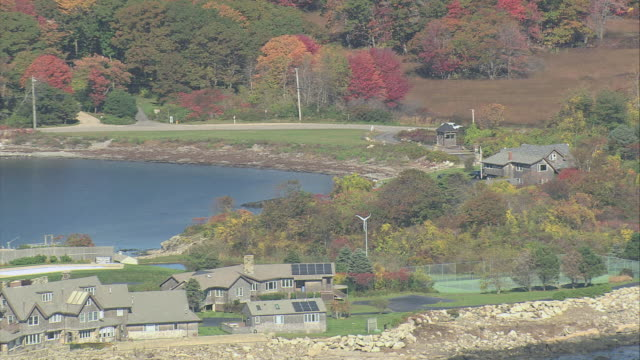AERIAL Walkers Point and the Bush family's summer home, with intense fall foliage on the mainland / Kennebunkport, Maine, United States