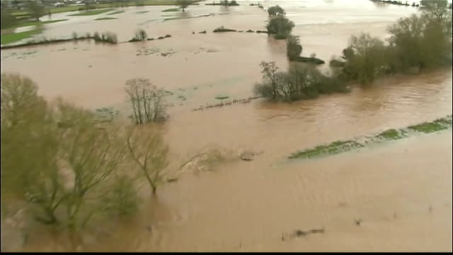stockvideo's en b-roll-footage met walkers warned about possible landslides following heavy rain and flooding england flooded land and partially submerged trees air view flooded... - mogelijk