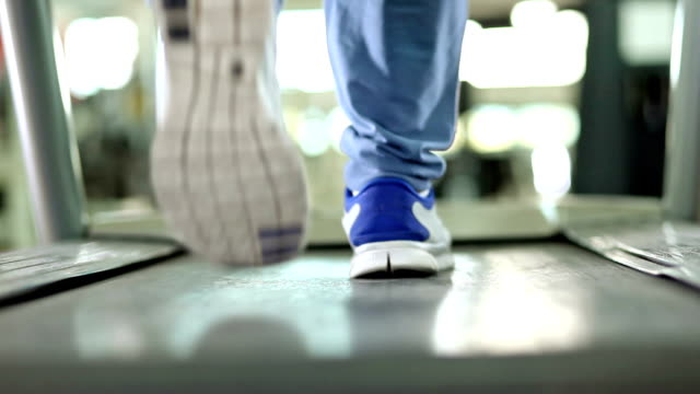 walkin on the treadmill - treadmill stock videos & royalty-free footage