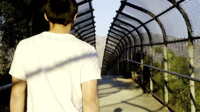 walking across bridge! - white shirt stock videos & royalty-free footage