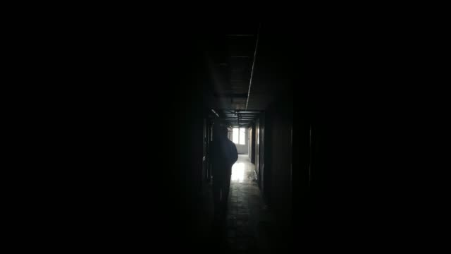 walking alone in the dark corridor - prison stock videos & royalty-free footage