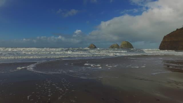 walking along a beautiful coastal beach with blue skies - fatcamera stock videos & royalty-free footage