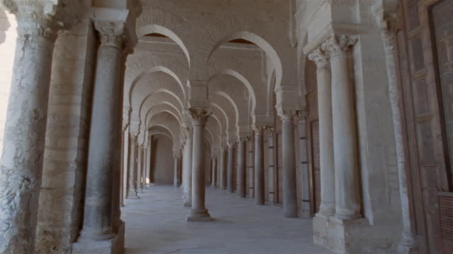 td, pov walking along colonnade in mosque of uqba, kairuan, tunisia - colonnade stock videos & royalty-free footage
