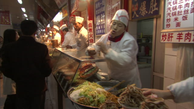 pov walking along counter in traditional chinese restaurant at night, beijing, china - chinese food stock videos & royalty-free footage