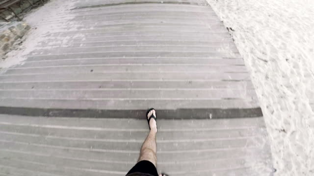walking along noosa heads beach - flip flop stock videos and b-roll footage