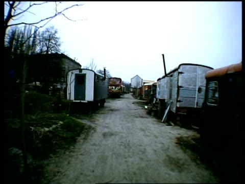 walking along path past travellers caravans berlin - new age stock videos & royalty-free footage