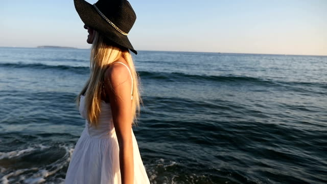 walking along the mediterranean sea - sun hat stock videos & royalty-free footage