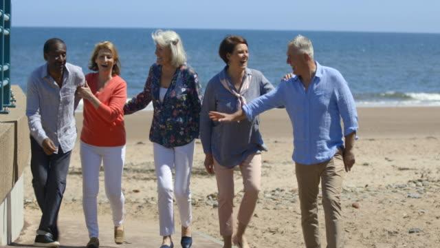 walking along the promonade - tourist resort stock videos & royalty-free footage