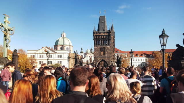 Walking Among Charles Bridge Tourists In Prag
