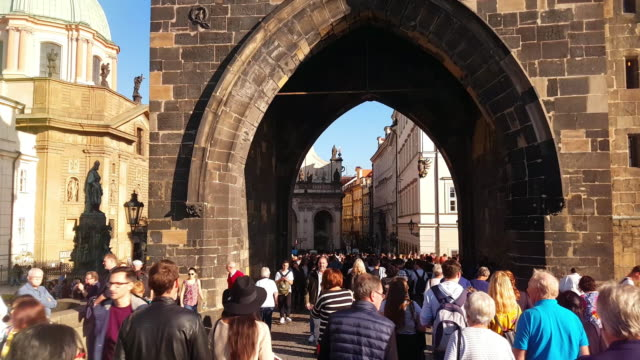 walking among charles bridge tourists in prag - prague stock videos & royalty-free footage