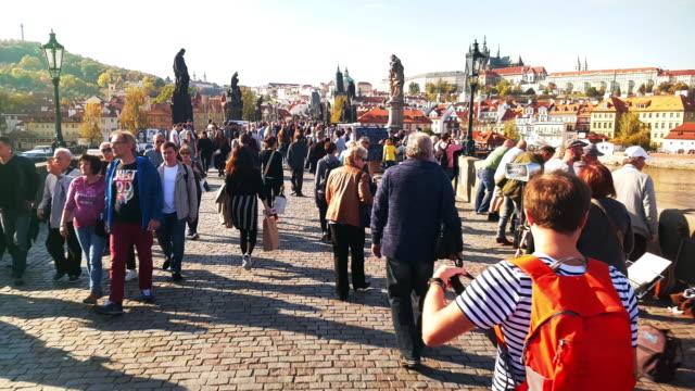Walking Among Charles Bridge Tourists In Prag