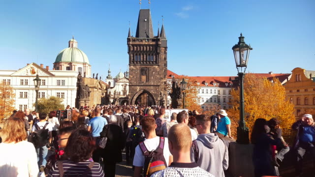 walking among charles bridge tourists in prag - charles bridge stock videos and b-roll footage